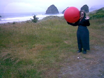 Annie with red ball by Pacific Ocean
