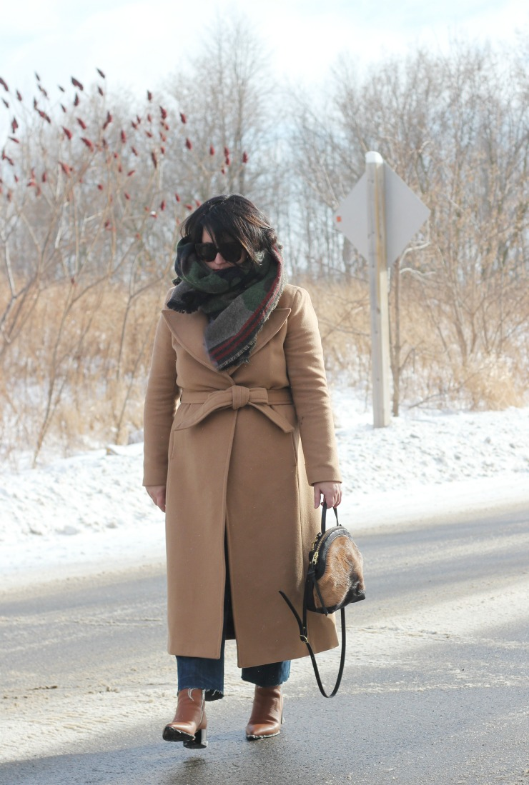 camel coat and camo scarf