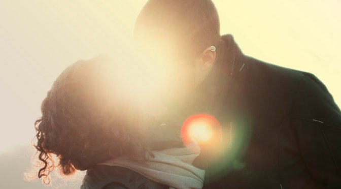 a-couple-kissing-in-sunlight