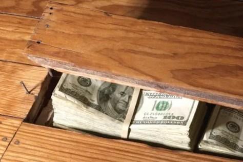Dollars hidden in floor board
