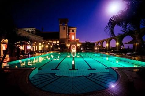The swimming pool at Lake Victoria Serena Golf Resort & Spa at night