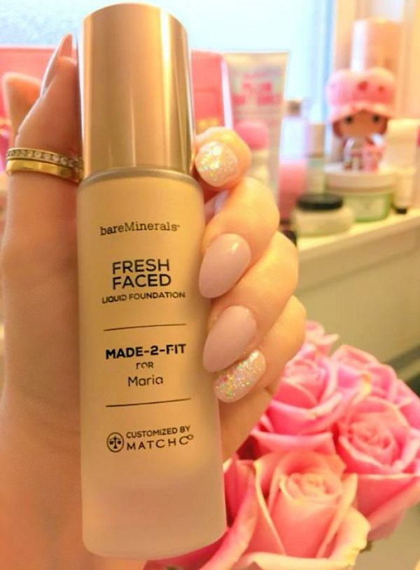 one more picture of a hand holding a BareMinerals foundation bottle