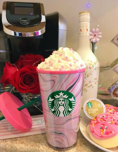 my pink Starbucks tumbler filled with whipped cream