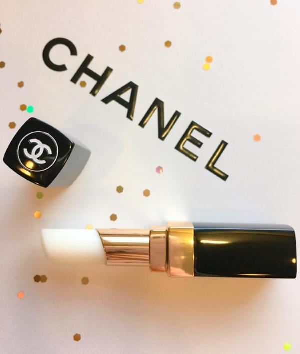 A flatlay with Chanel's Coco Baume