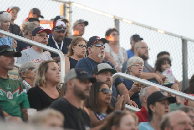 Randy Riggs, host father of Chico Heat's Tanner Roundy, watches a game Thursday at Nettleton Stadium. (Carin Dorghalli -- Enterprise-Record)