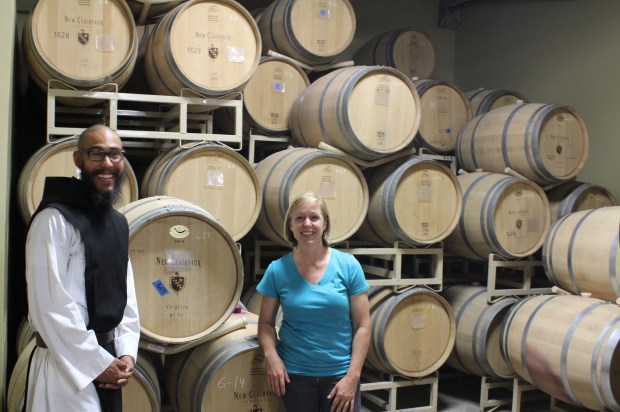 Vineyard manager Brother Luis and winemaker Aimee Sunseri stand Saturday with barrels in the winery at the Abbey of Nwe Clairvaux in Vina. (Steve Schoonover -- Enterprise-Record)