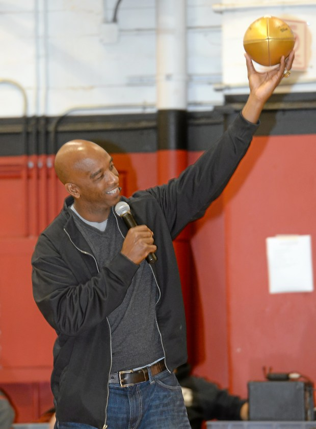 FILE PHOTO: Mike Sherrard, a 1981 graduate of Chico High School presents Chico High School with an NFL Super Bowl 50 commemorative golden football. - Bill Husa --Enterprise-Record