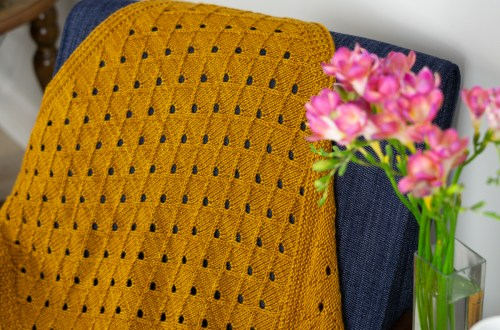 Mustard yellow worsted weight KiYO baby blanket