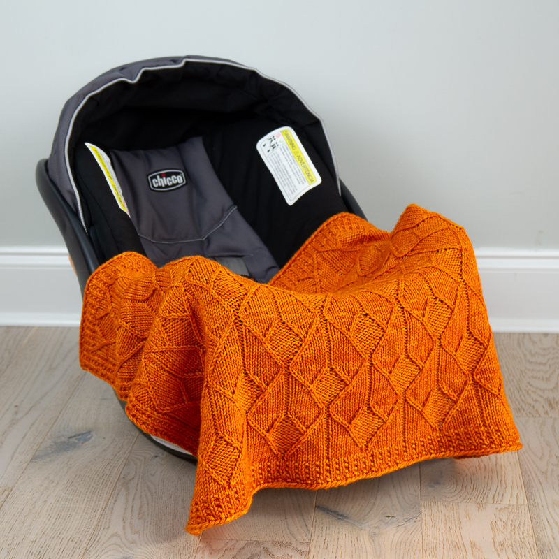 Sérac blanket on car seat