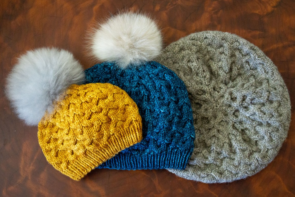 3 sizes of Astrophil Hat in yellow, blue and gray