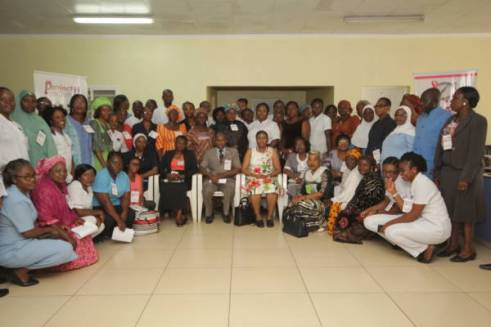 Ninety (99) nurses and retired midwives in a Group Photograph during the Sensitization Forum on Breast Cancer Navigation and Palliative Programme(BCNPP) at the Trauma Centre, National Hospital Abuja.