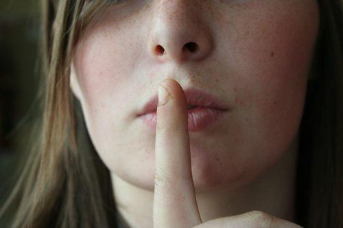 Shh - finger over mouth