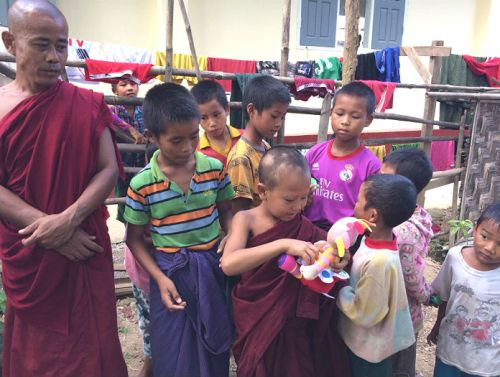 orphans with toys at sasana orphanage - children do matter