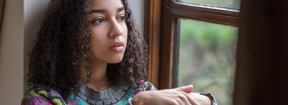 photo of teen girl looking thoughtful