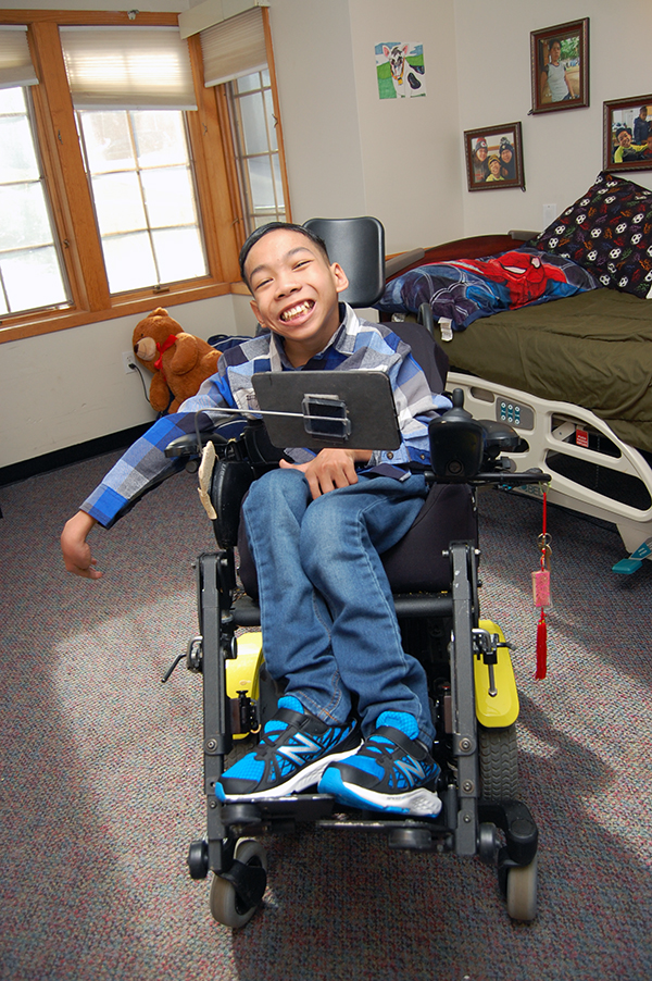 Smiling kid in wheelchair