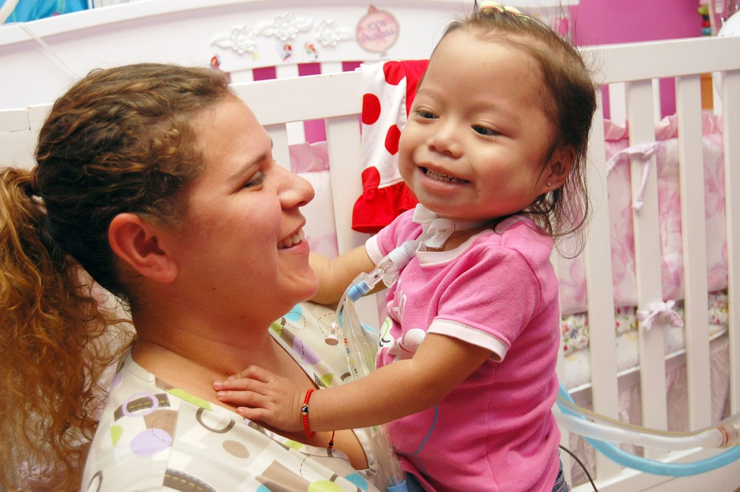 Homecare nurse with smiling child