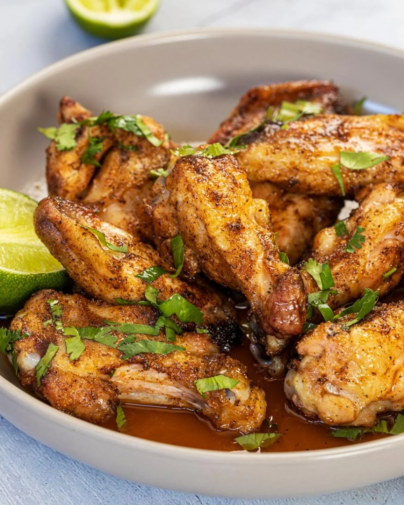plate of chipotle and roasted garlic wings