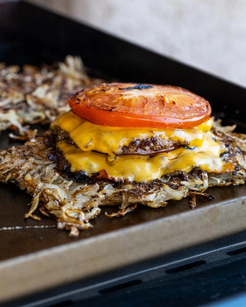 smash burgers with cheddar, tomatoes, and hash browns