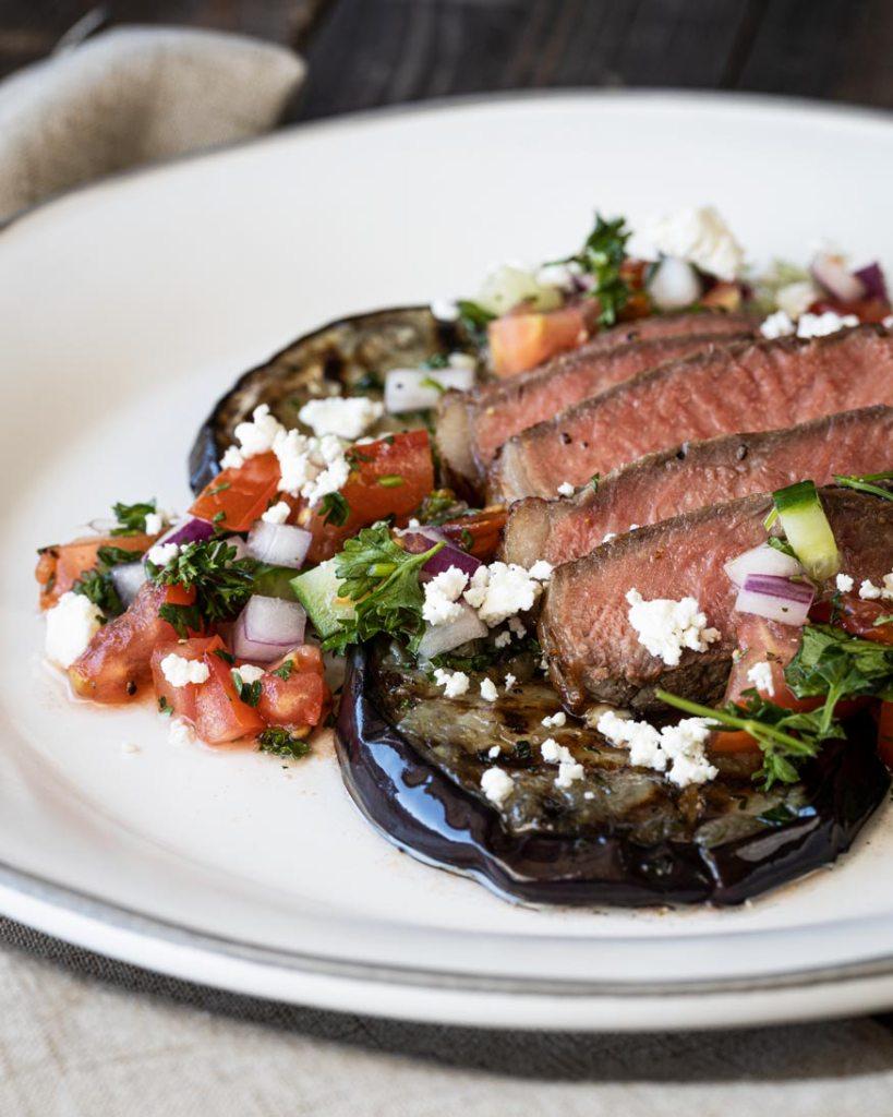 steak, eggplant, and salad