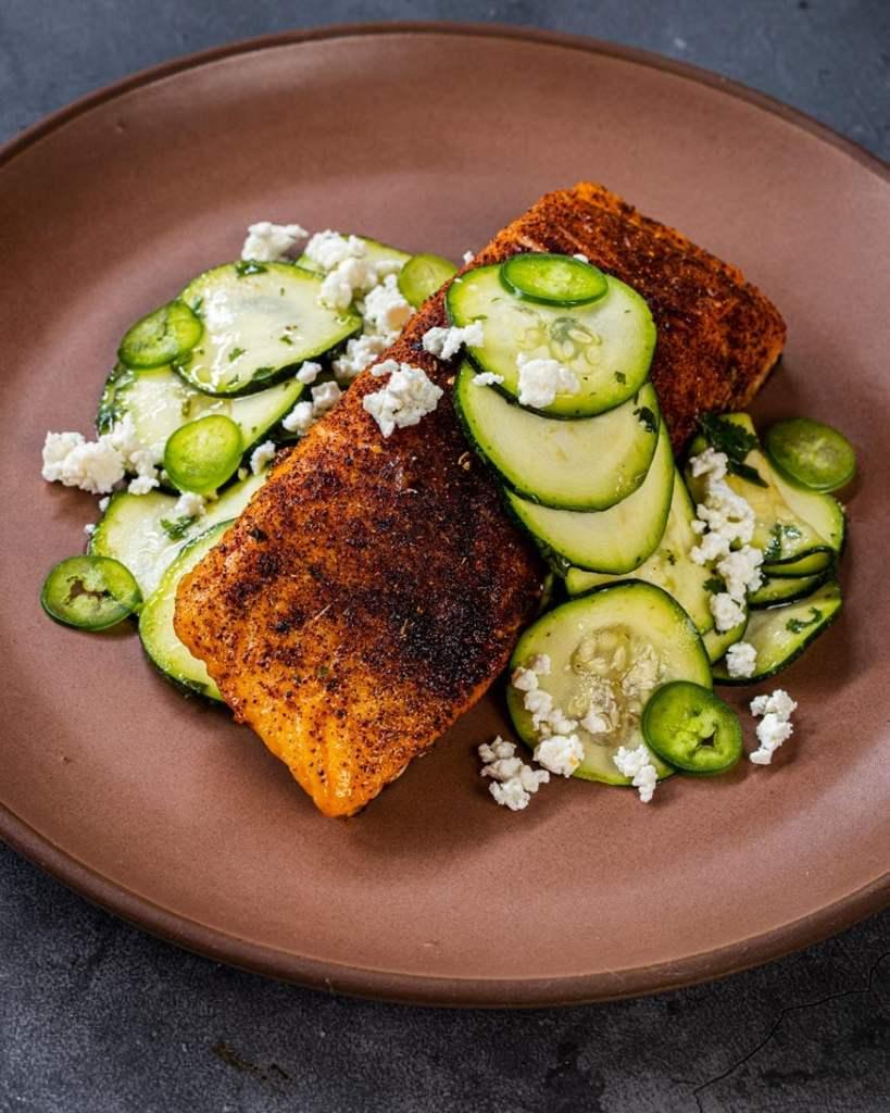 Hot smoked salmon, plated with fresh zucchini salad.
