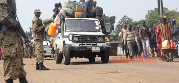 A South Sudanese family arrives in Uganda after evacuation by the UPDF (Photo: Kenneth Kazibwe/ChimpReports)