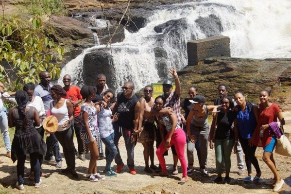 Some of the group members pose for a photo in front of Murchison Falls