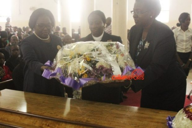 Justice Catherine Bamugemereire (L) lays a wreath