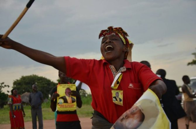 An excited NRM supporter cheers Etuka