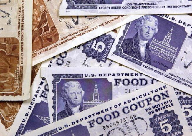 低价购粮食券买菜  餐馆老板被捕