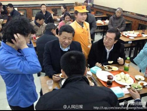Xi shows common touch with visit to bun eatery