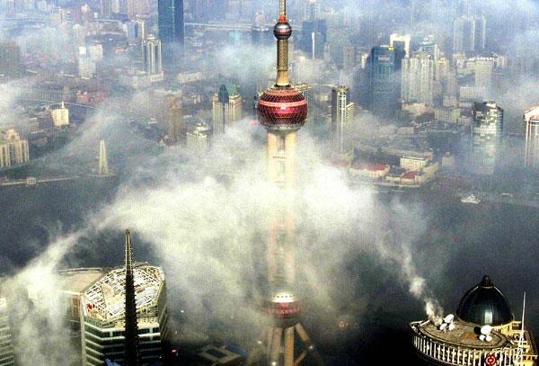 Fog clouds Shanghai's skyscrapers