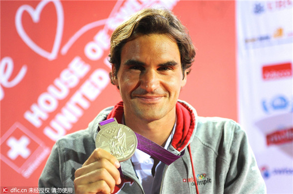 Image result for pic of roger federer with olympic silver medal