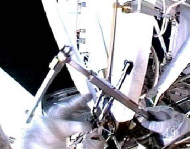 Astronauts conduct spacewalk