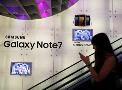 A woman passes a Samsung Note 7 advertisement in Singapore