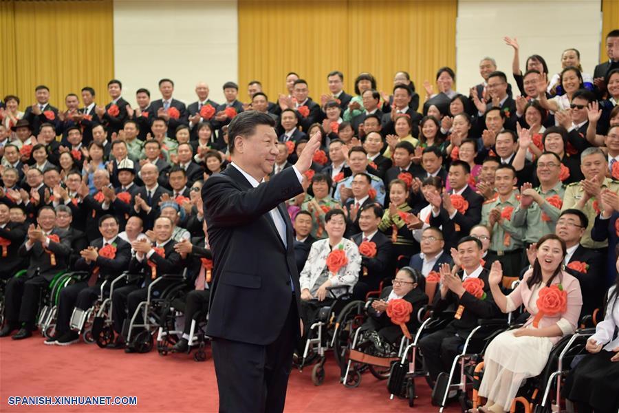 Xi se reúne con discapacitados modelo y sus simpatizantes más destacados