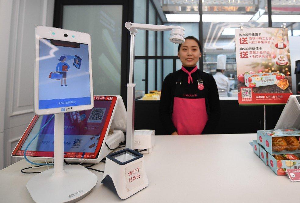 Pagos móviles aceleran consumo familiar chino: encuesta