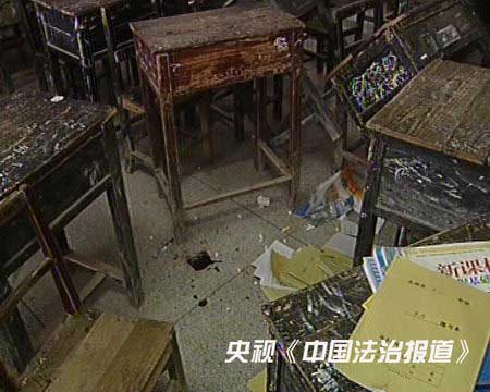 Between the desks of this classroom where 11-year-old Zhang Yaoyin was beaten by her teacher are bloodstains.