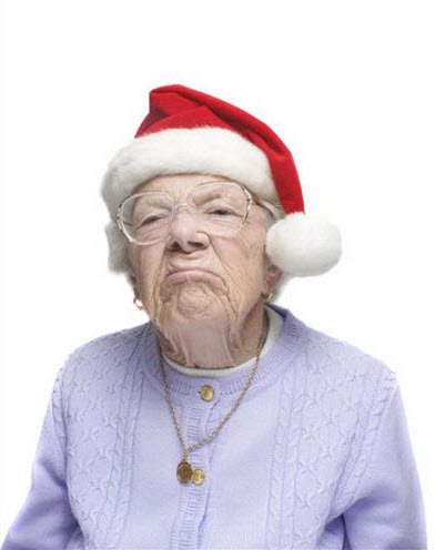 Crazy old lady wearing Santa's hat.