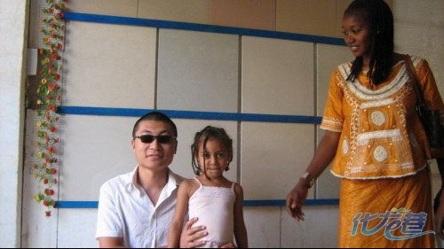 A Chinese and African couple with their child.