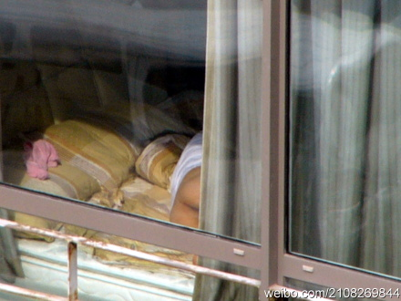 A Chinese woman who is regularly seen naked through her apartment window.
