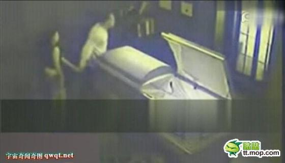 A couple leaves after having sex in a coffin.