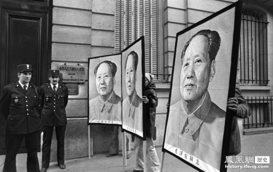 Portraits of Mao Zedong in front of the Chinese embassy in Paris, France following the Chinese leader's death.