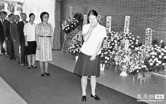 A Japanese girl cries in Tokyo while mourning Mao Zedong's death.