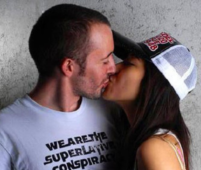 A Chinese Girl Kissing Her Western White Boyfriend