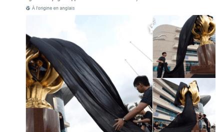 Le symbole de la rétrocession drapé de noir