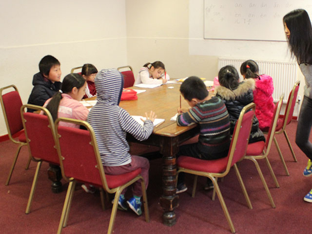 Kids are settled in class learning Mandarin Chinese