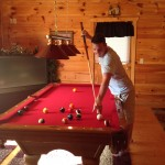 mike playing pool