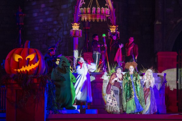 """New in 2015, the """"Hocus Pocus Villain Spelltacular,"""" show during Mickey's Not-So-Scary Halloween Party at Magic Kingdom Park features the mischievous Sanderson Sisters from Disney's Hocus Pocus, who throw an evil Halloween party with appearances by Dr. Facilier, Oogie Boogie, Maleficent and other Disney villains, along with dancers, projections and special effects. Walt Disney World Resort is located in Lake Buena Vista, Fla. (David Roark, photographer)"""