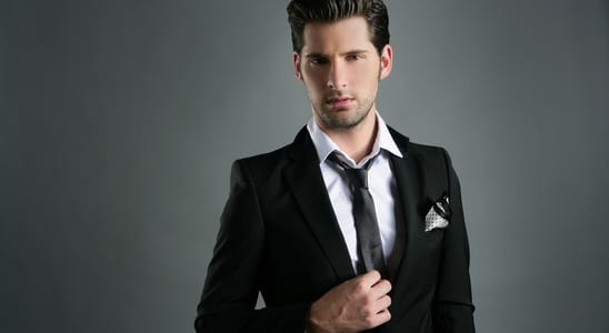 Fashion young businessman black suit casual tie