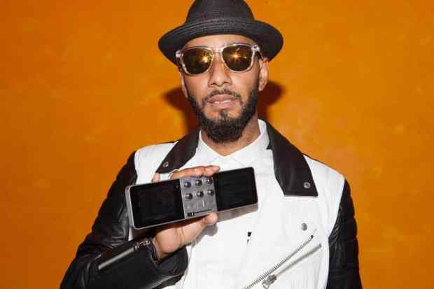 Swizz Beats holding the Monster DJ-Go